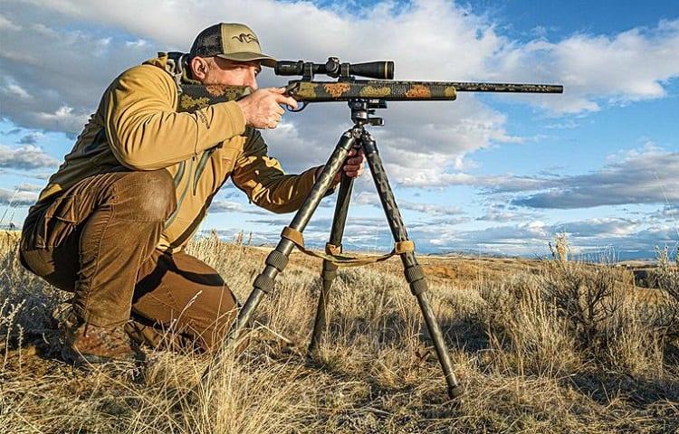 hunter with rifle tripod